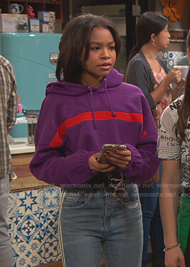 Nia's purple cropped hoodie and side stripe jeans on Ravens Home