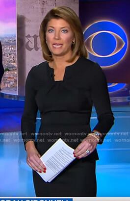 Norah's black twisted neck peplum top on CBS Evening News
