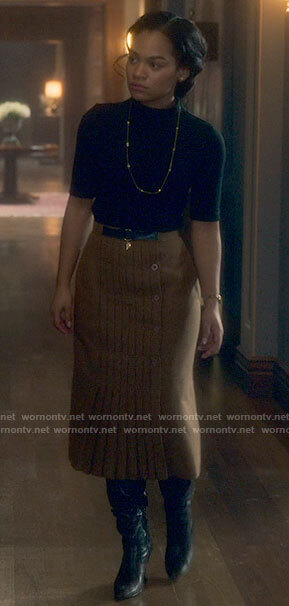 Rebecca's black top and pleated camel skirt on The Haunting of Bly Manor