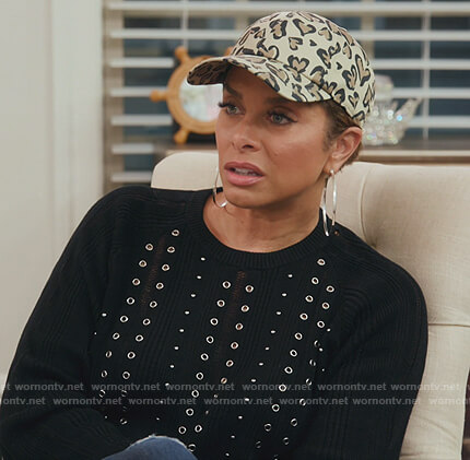 Robyn's black grommet embellished sweater on The Real Housewives of Potomac