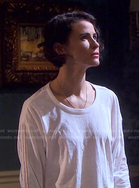 Sarah's white top with multicolor stitching on Days of our Lives