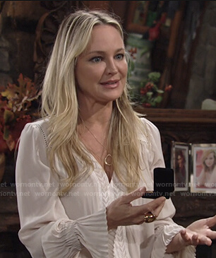 Sharon's white v-neck pleated cuff blouse on The Young and the Restless