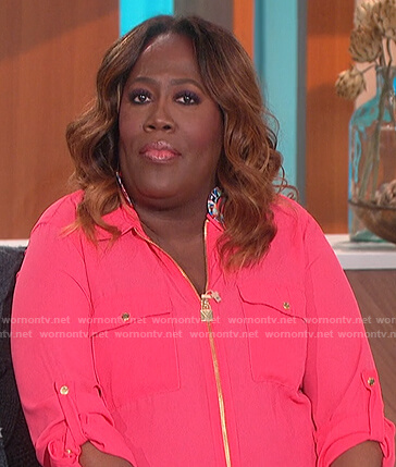 Sheryl's pink lock zip blouse on The Talk