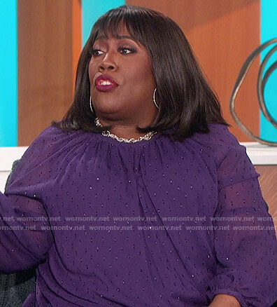 Sheryl's purple sheer top on The Talk