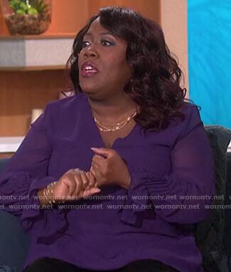 Sheryl's purple sheer top on The Talk