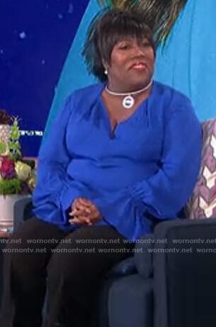 Sheryl's blue ruffle cuff blouse on The Talk