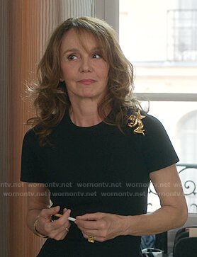Sylvie's gold angel brooch on Emily in Paris