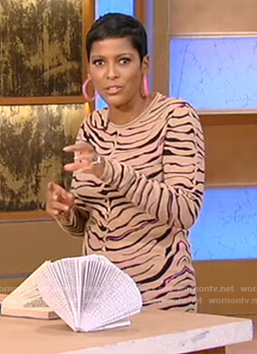 Tamron's tiger stripe sweater and skirt on Tamron Hall Show