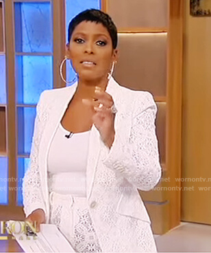 Tamron's white lace blazer and pants on Tamron Hall Show