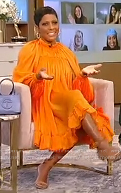 Tamron's orange satin dress on Tamron Hall Show