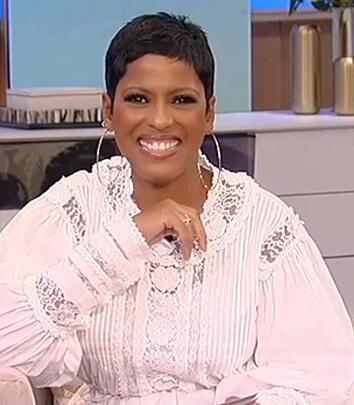 Tamron's white lace blouse on Tamron Hall Show