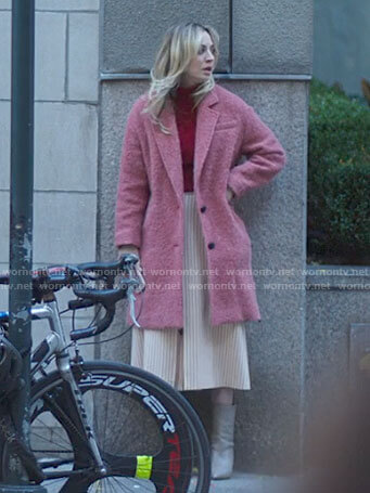 Cassie's pink textured coat on The Flight Attendant
