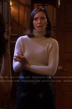 Gwen's beige turtleneck sweater on Days of our Lives
