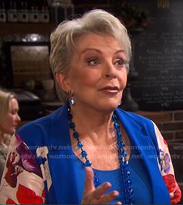 Julie's blue floral-sleeve jacket on Days of our Lives