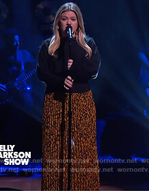 Kelly's black button sweater and floral skirt on The Kelly Clarkson Show