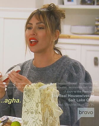 Kelly's gray puff sleeve sweater on The Real Housewives of Orange County