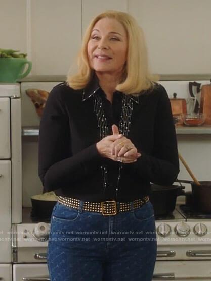 Margaret's black embellished blouse and monogram jeans on Filthy Rich