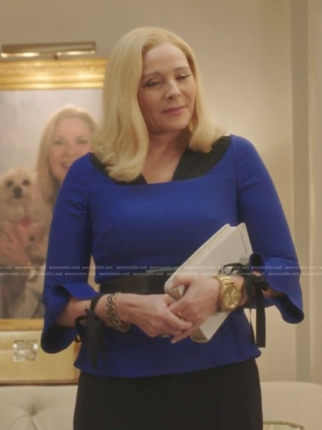 Margaret's blue tie-sleeve top on Filthy Rich