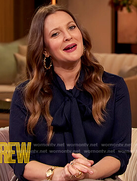 Drew's blue tie neck blouse and pleated skirt on The Drew Barrymore Show