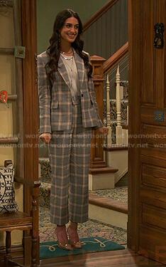 Priya's grey plaid suit on Ravens Home