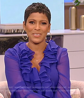 Tamron's blue sheer ruffle dress on Tamron Hall Show