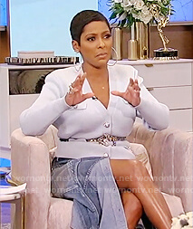 Tamron's blue cardigan and denim skirt on Tamron Hall Show