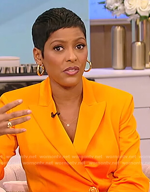 Tamron's orange double breasted blazer on Tamron Hall Show