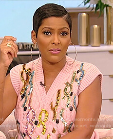 Tamron's pink sequin embellished sweater vest on Tamron Hall Show