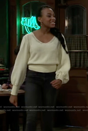 Trina's yellow open stitch sweater on General Hospital