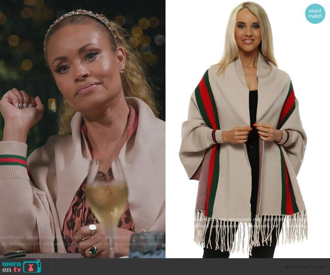 Beige Italian Ribbon Sleeved Cape by Yu&Me worn by Gizelle Bryant  on The Real Housewives of Potomac