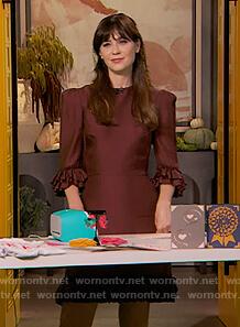 Zooey Deschanel's burgundy ruffle dress on The Drew Barrymore Show