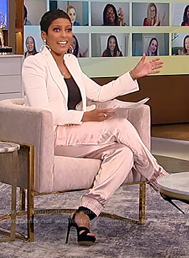 Tamron's pink satin pants and white blazer on Tamron Hall Show