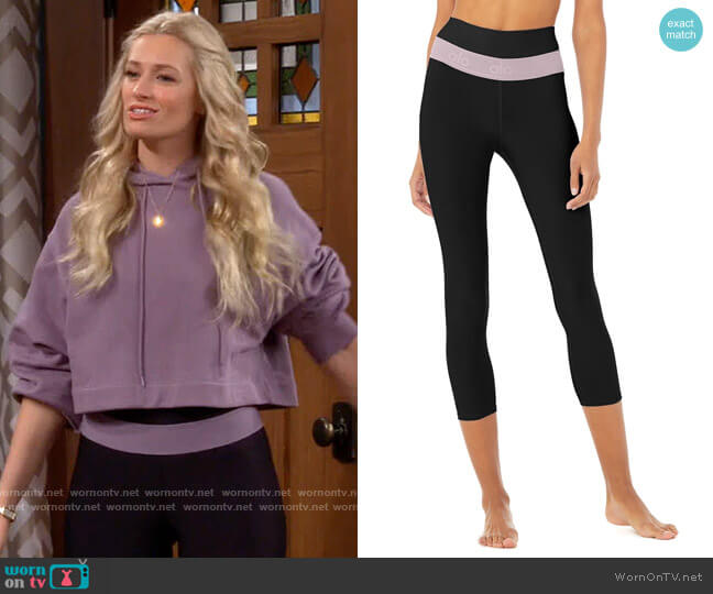 Alo Yoga High Waist Capri Fitness Leggings in Black / Lavender Smoke worn by Gemma (Beth Behrs) on The Neighborhood