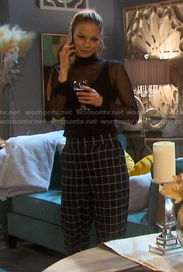 Ava's black mesh turtleneck top and check pants on Days of our Lives