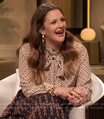 Drew's geometric print tie neck blouse on The Drew Barrymore Show