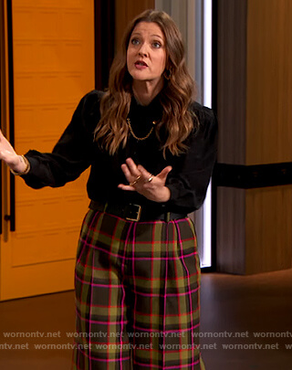 Drew's black chain embellished blouse and plaid pants on The Drew Barrymore Show