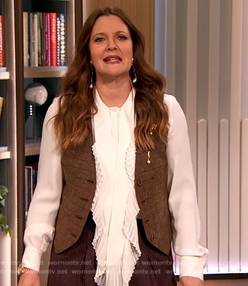 Drew's white ruffle blouse and vest on The Drew Barrymore Show