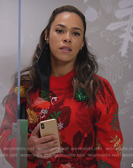 Emily's red flamingo Christmas sweater on All Rise