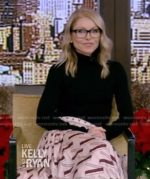 Kelly's black sweater and pink print pleated skirt on Live with Kelly and Ryan