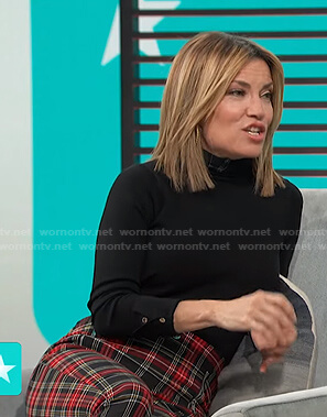 Kit's black turtleneck sweater and check pants on Access Hollywood