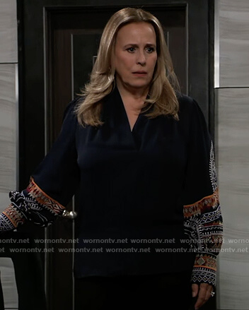 Laura's blue embroidered wrap blouse on General Hospital
