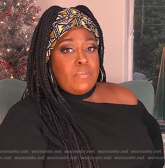Loni's black shoulder cutout sweater on The Real