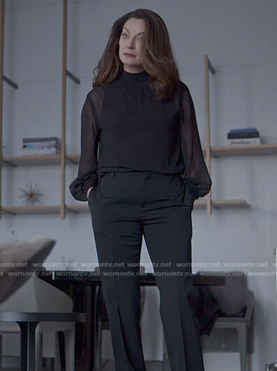 Miranda's black sheer blouse on The Flight Attendant
