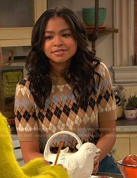 Nia's beige short sleeve argyle sweater on Ravens Home