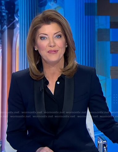 Nora's navy contrast blazer on CBS Evening News