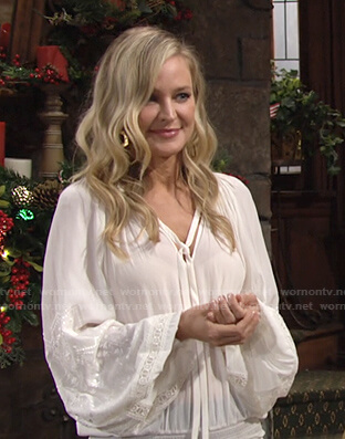 Sharon's white embroidered tie neck top on The Young and the Restless