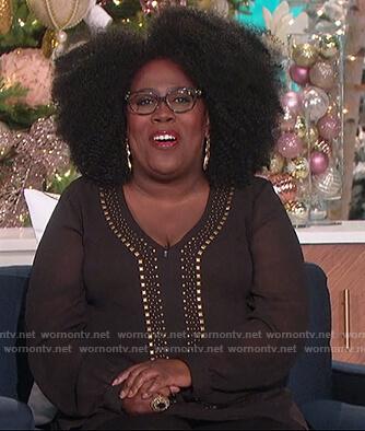 Sheryl's black studded blouse on The Talk