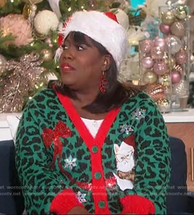 Sheryl's green Christmas cat cardigan on The Talk
