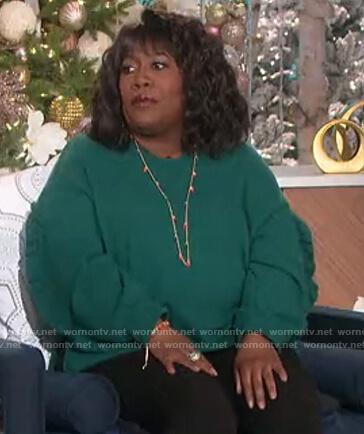 Sheryl's green ruffle trim sweater on The Talk