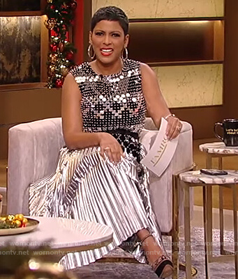 Tamron's metallic chainmail top and pleated skirt on Tamron Hall Show